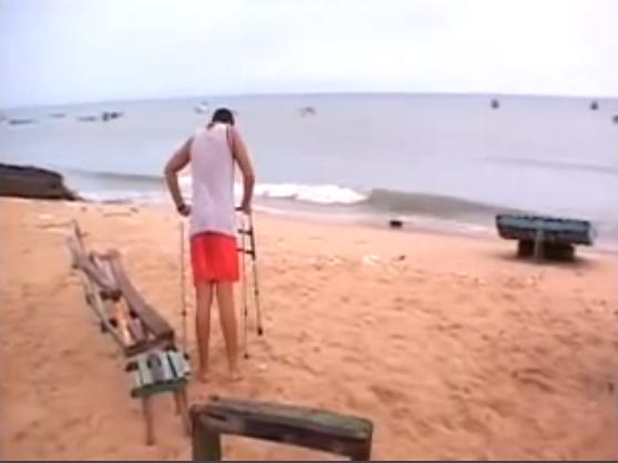 imagem de pescador de lagosta com deficiência física.
