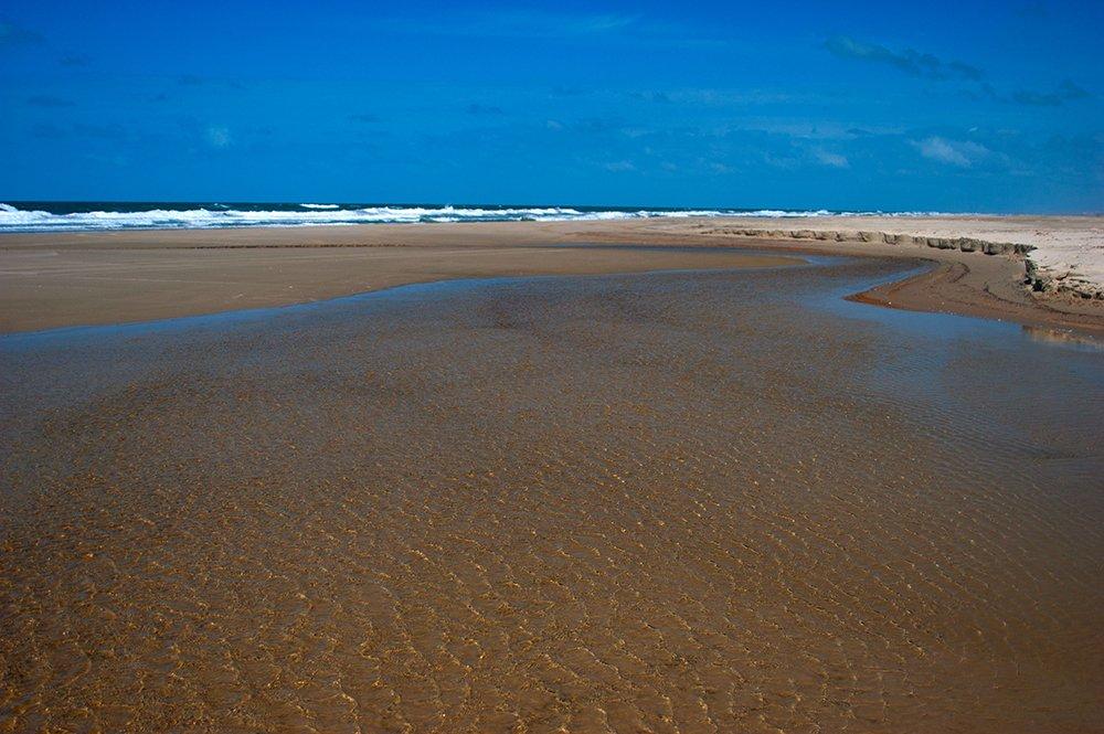 imagem de arroio na praia do Cassino