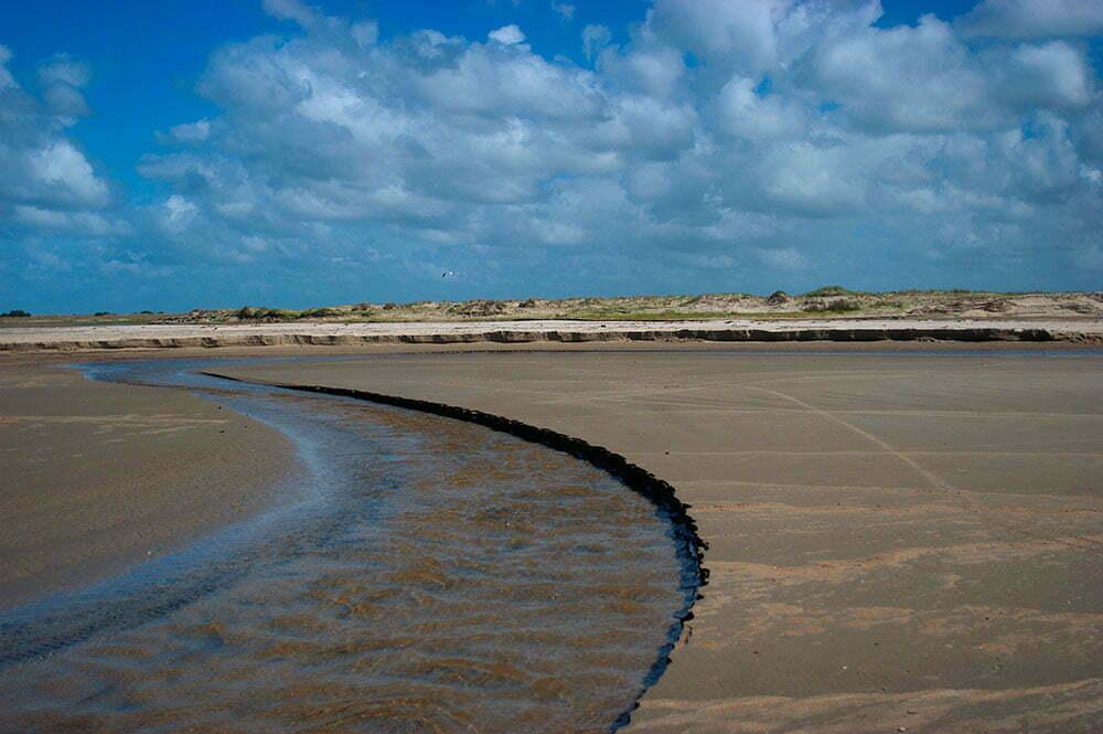 imagem de arroio em praia gaúcha